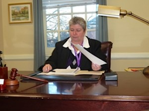 Bonnie at her desk in Annapolis